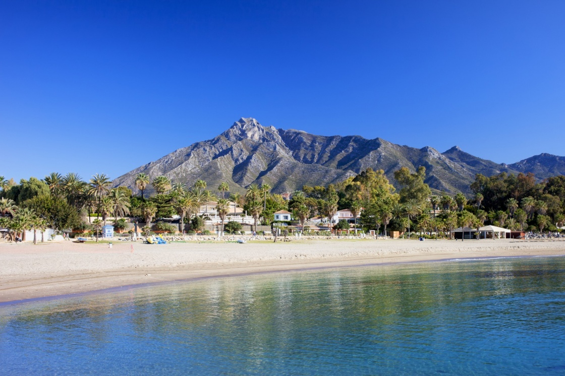 'Marbella sandy beach, summer holiday scenery by the Mediterranean Sea in Spain, Andalusia region, Costa del Sol, Malaga province.' - Andalusia