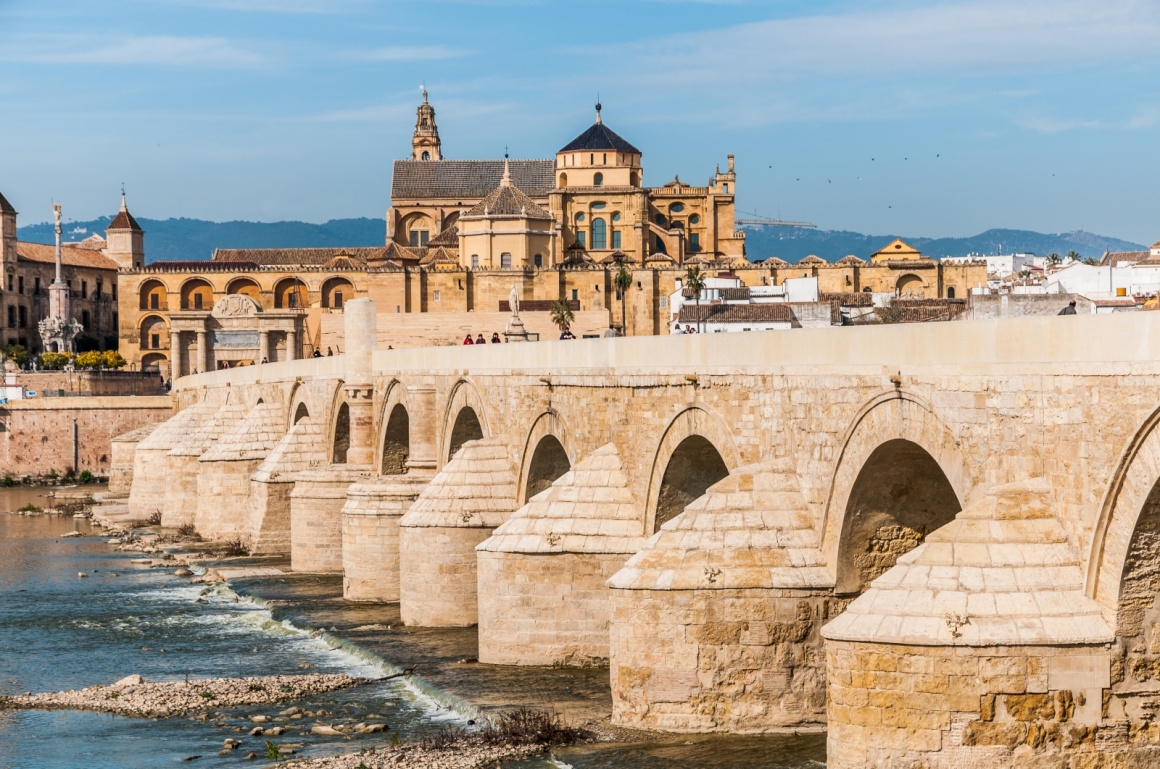 'View of Great Mosque of Cordoba across famous Roman Bridge' - Andalusia