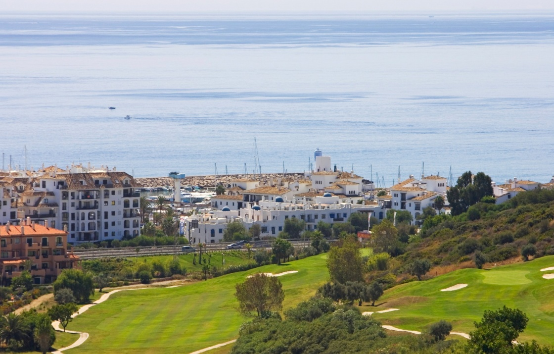 View of Duquesa golf course apartments and down to the sunny Mediterranean Sea in Spain on the Costa del Sol